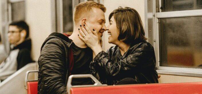 romantic couple at public transportation