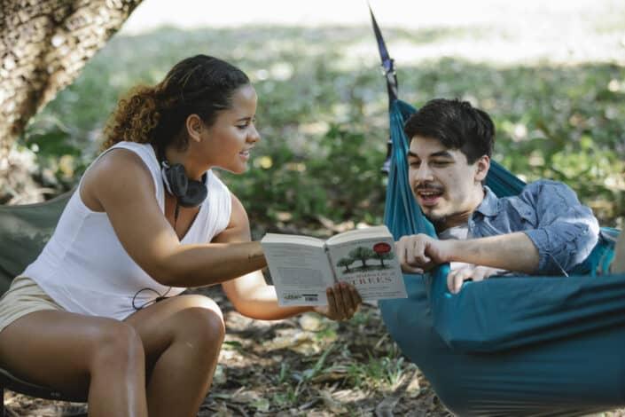 Woman sharing book to her boyfriend