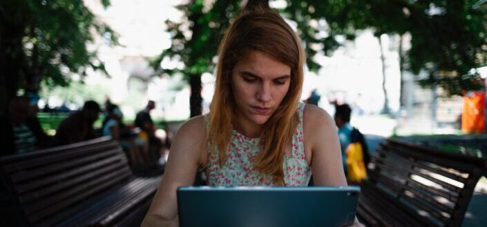 woman furiously staring at her laptop screen