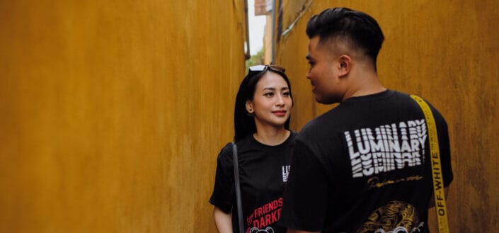 Couple talking in a corridor