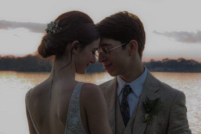 a romantic couple on a date near a lake