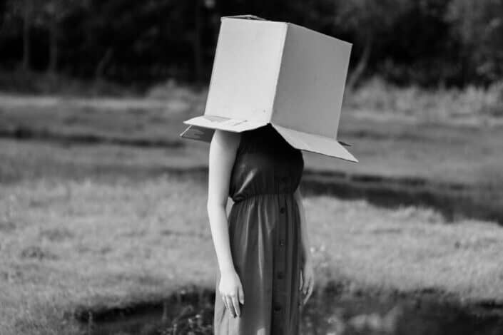 a mysterious woman with an open box in her head