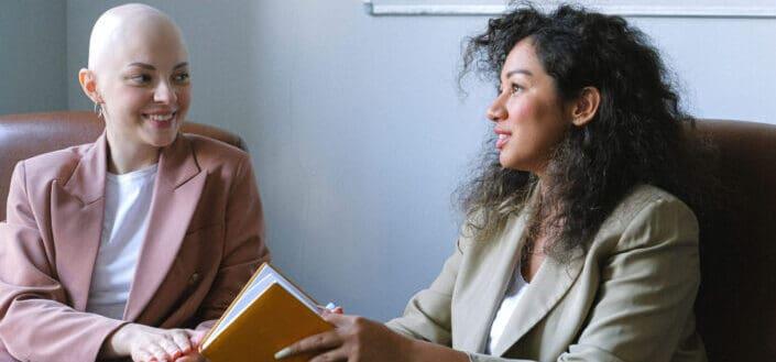 two smiling women having deep talks