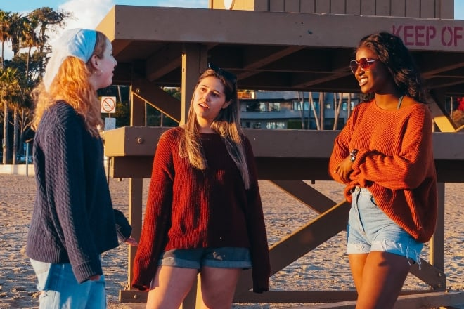 three young diverse women talking to each other - Random Questions To Ask A Girl