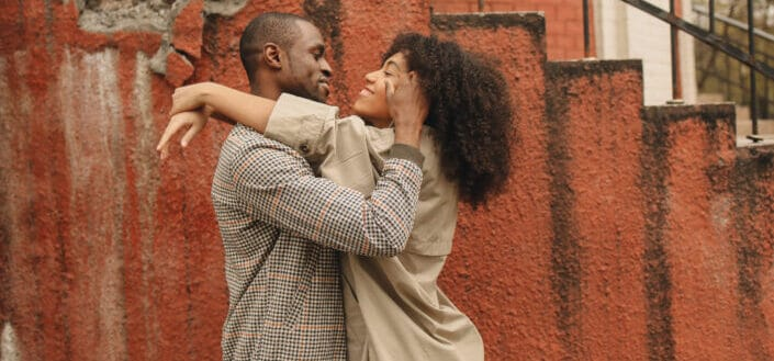 Multiracial couple Hugging Each Other