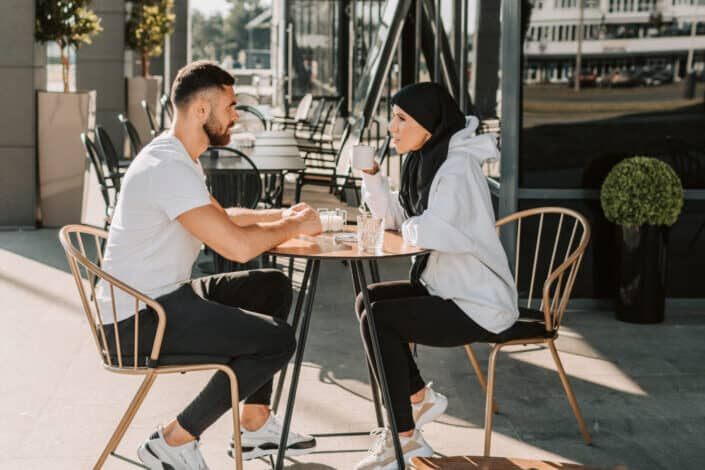 Man and Woman Sitting on Restaurant