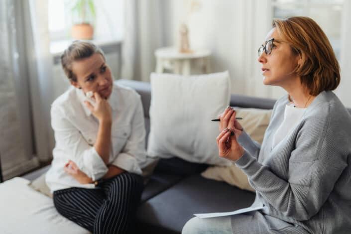 Two women talking seriously.