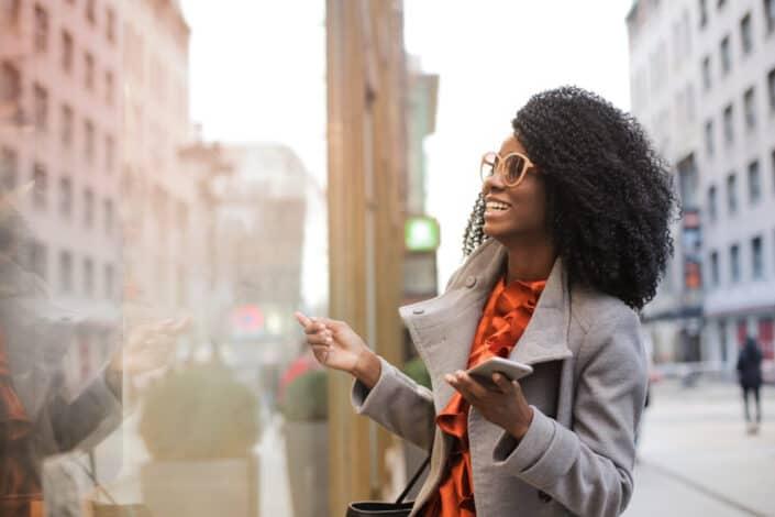 A stylish traveler woman delightedly enjoying her surrounding.