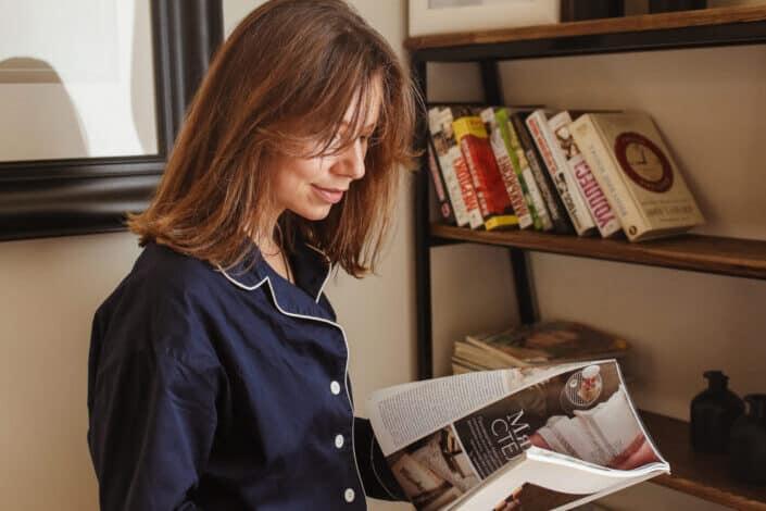 A woman reading a magazine.