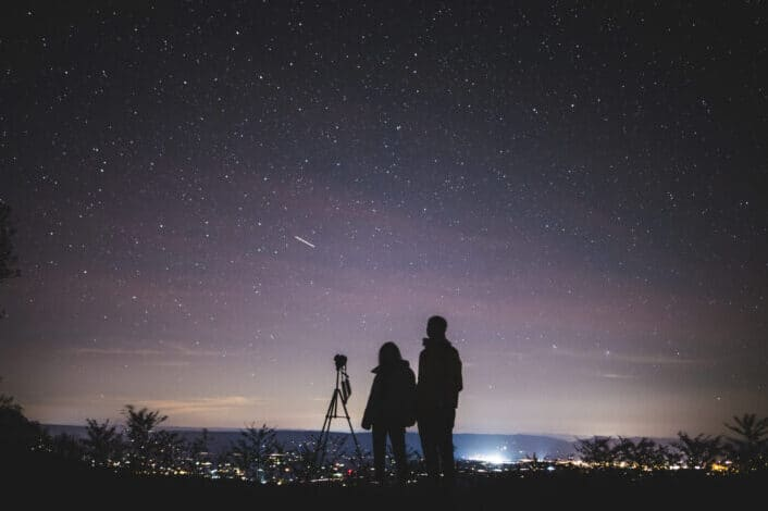 Silhouette of Two Persons Stargazing