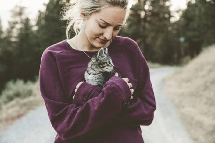 Woman cuddling a kitten