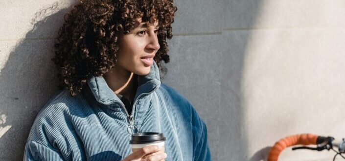 A woman with cup of takeaway coffee.