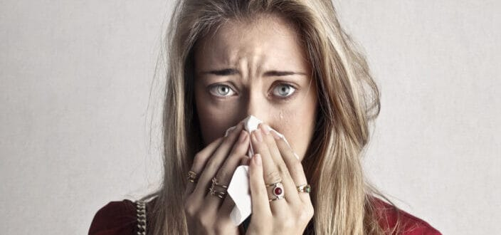 Crying Woman in Blowing Her Nose